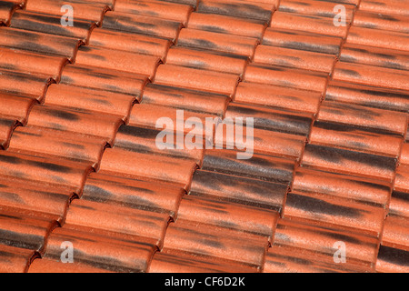 Old terracotta tile roof, detailed structure view at an angle the tiles - Stock Photo
