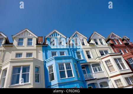 Colourful painted buildings along the seafront at Aldeburgh. - Stock Photo
