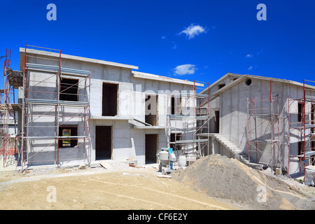 Building of new two-story white concrete house with stairs and balcony - Stock Photo