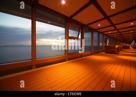 corridor on cruise ship. row of lamps. beautiful view  through window. - Stock Photo