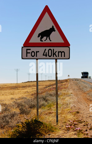 Brown hyena crossing sign along the tarmac road between Aus and Luderitz. Namibia - Stock Photo