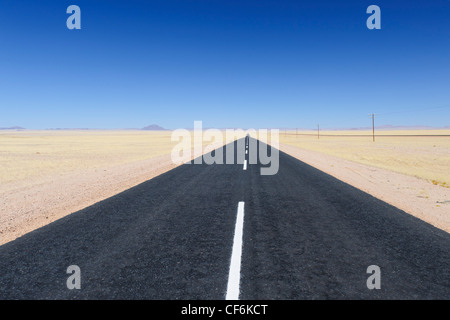 The road through the desert between Aus and Luderitz. Southern Namibia. - Stock Photo
