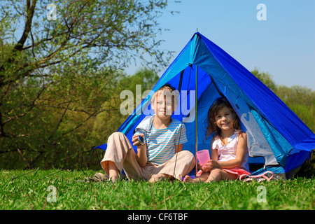 children in tent sunny day - Stock Photo