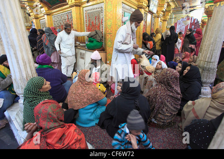 India; Delhi; Nizamuddin Chisti; muslim; sufi; saint; shrine; Dargah Hazrat Nizamuddin Aulia; people; - Stock Photo