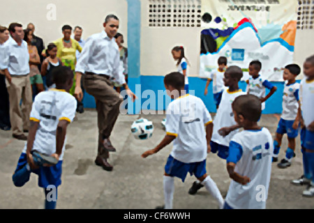 President Barack Obama plays soccer with children at the Cidade de Deus, City of God favela Community Center March - Stock Photo