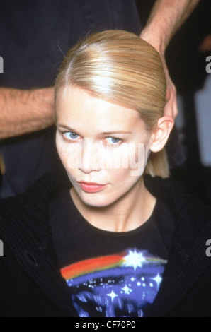 Helmut Lang Backstage New York A W German supermodel Claudia Schiffer having her side parted sleek hair pulled back - Stock Photo