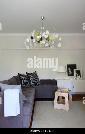 Apartment in Sydney Living room interiwith corner sofa from Habitat, white metallic low cabinet from Ikea, Butterfly - Stock Photo