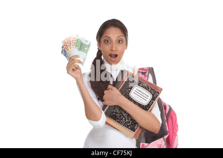 Ethnic Indian college student with money 100 (one hundred) 50 (fifty) 20 (twenty) euro bills happy for help to pay - Stock Photo