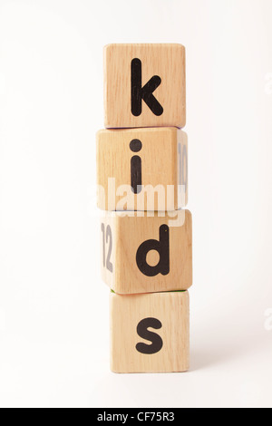 Stacked wooden blocks spelling the word kids - Stock Photo