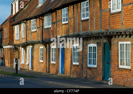 Terrace of brick-built houses in the village of North Warnborough, Hampshire, England UK - Stock Photo