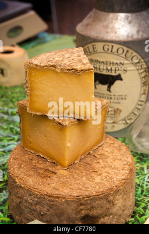 UK, Gloucestershire, Stroud, Union Street, weekly farmer's market, traditional farmhouse Double Gloucester cheeses - Stock Photo