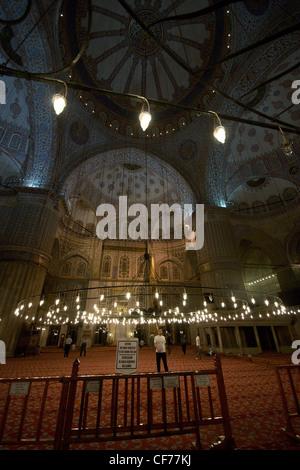 Man inside Blue Mosque - Stock Photo