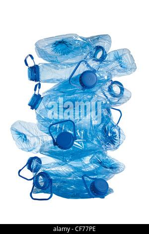 stack of used blue plastic crushed bottles isolated on white background - Stock Photo