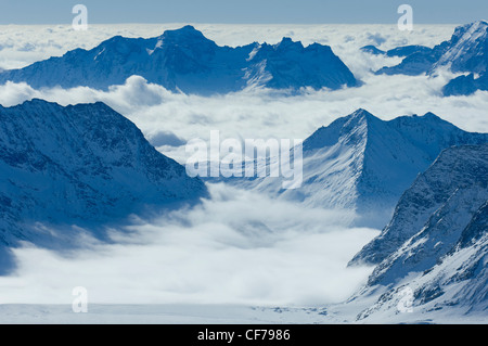 Looking down the Aletsch Glacier from the Jungfraujoch, towards cloud wreathed peaks, Valais, Switzerland - Stock Photo