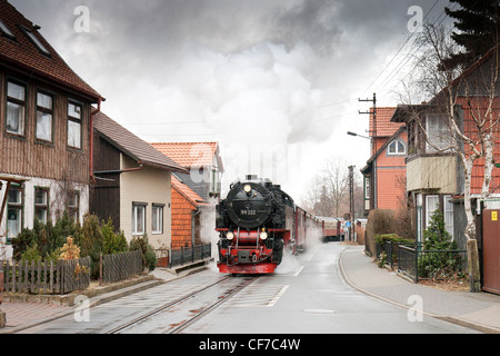 A steam locomotive pulling a passenger train on the Harz Mountain Railway to the Brocken - Stock Photo