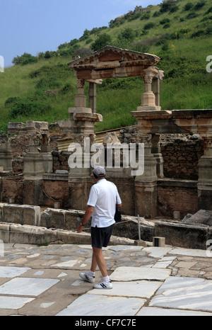 Tourist walking down the Street of the Curetes Ephesus Turkey - Stock Photo