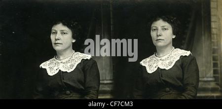 woman in black dress 1800s 1900s white lace collar fashion women's sad quiet portrait - Stock Photo