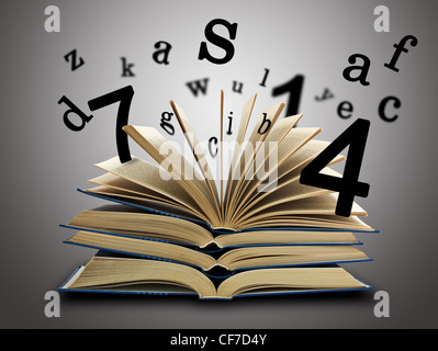 The Magic Book and the letters, numbers on a dark background. Education concept - Stock Photo