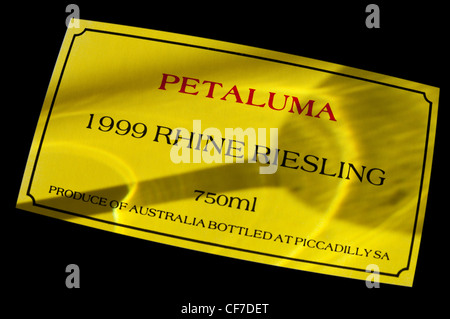 1999 Petaluma Riesling wine bottle label with shadow of wine tasting glass Clare Valley, South Australia, Australia - Stock Photo