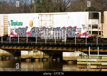 'The Great Escape' graffiti on a Tropicana boxcar on a CSX railroad bridge crossing over the Anacostia River in - Stock Photo