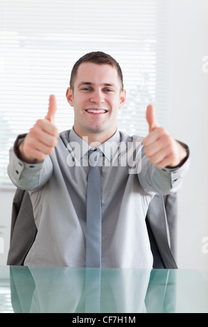 Close up of businessman giving his okay - Stock Photo