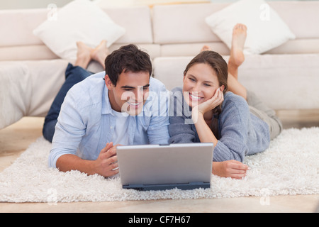 Young couple looking for something on the internet - Stock Photo