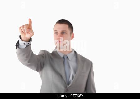 Businessman touching something - Stock Photo