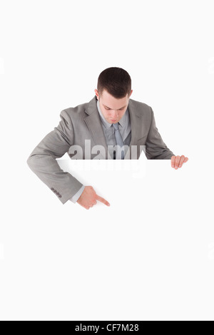 Portrait of a businessman pointing at something on a panel - Stock Photo