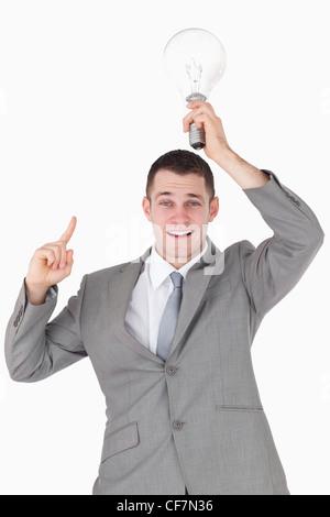 Portrait of a businessman having an idea - Stock Photo