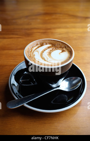 Flat White Coffee with Standard or Simple Rosetta Artistic Design in the Foam. New Zealand - Stock Photo