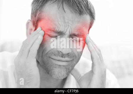 Man having a headache - Stock Photo