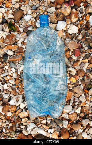 plastic bottle washed up on the beach - Stock Photo