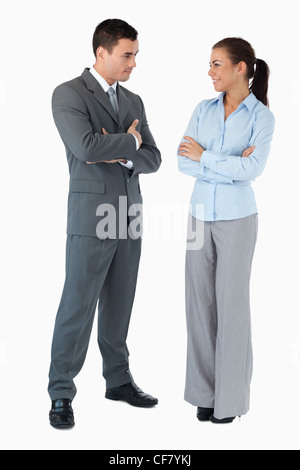 Business partner looking at each other against a white background - Stock Photo