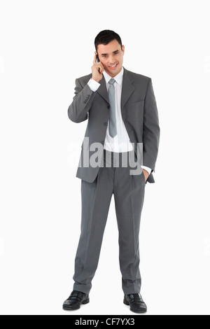 Businessman on the phone against a white background - Stock Photo
