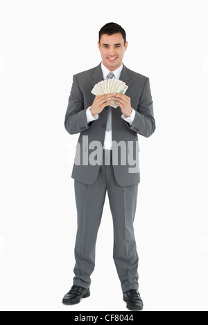 Businessman with banknotes - Stock Photo