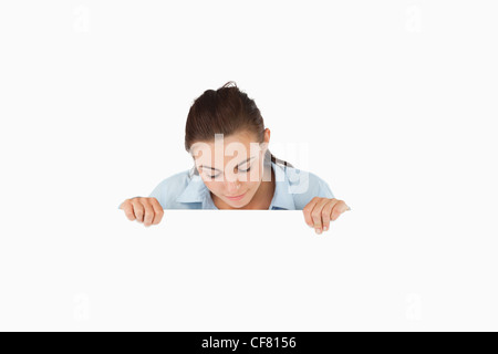 Businesswoman looking down on sign - Stock Photo