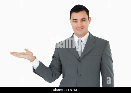Businessman presenting something in his palm - Stock Photo
