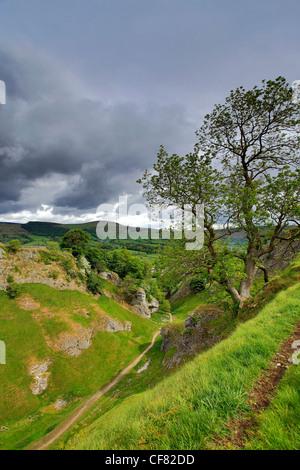 Summer Cave Dale Peveril Castle, Castleton village, Hope Valley, Peak District National Park, Derbyshire, England, - Stock Photo