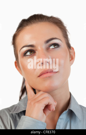 Close up of thinking young businesswoman - Stock Photo