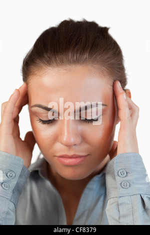 Close up of businesswoman suffering from a headache - Stock Photo