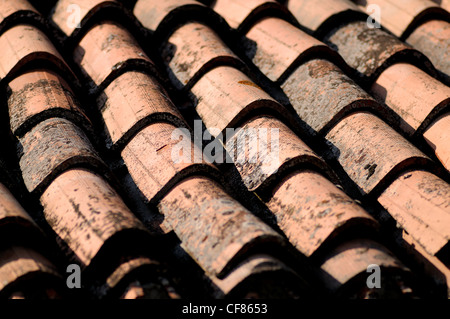 Old red terracotta tiles roof in Tuscany cover pattern background - Stock Photo