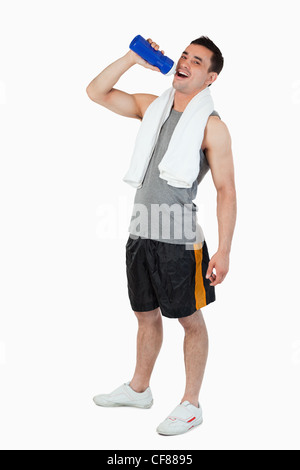 Young man drinking water after workout - Stock Photo