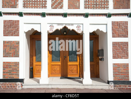 Red brick, white wood: typical half-timbered farmhouse at Jork in the fruit-growing Altes Land region in Lower Saxony, - Stock Photo