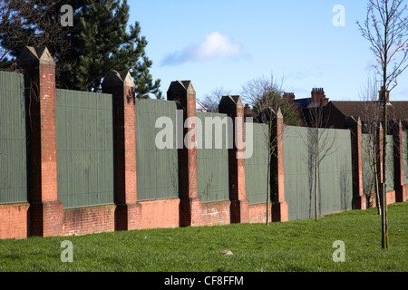 The peace line wall separating catholic ardoyne from protestant glenbryn on alliance avenue in north Belfast Northern - Stock Photo