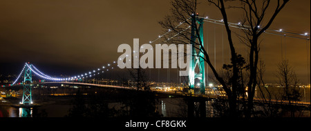 Lions Gate Bridge Over Burrard inlet in Vancouver Bc Canada at night Panorama - Stock Photo