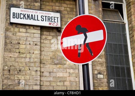 No Entry sign defaced to look like part of it is being stolen. The sign is in the west end of London, England. - Stock Photo