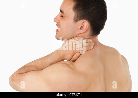 Young man suffering from neck pain - Stock Photo