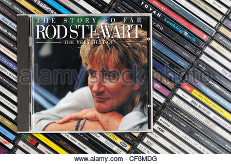 The Story So Far, The Very Best Of Rod Stewart album on a stack of CD cases, England - Stock Photo
