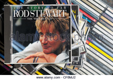 The Story So Far - The Very Best Of Rod Stewart album on a stack of CD cases, England - Stock Photo