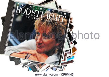 The Story So Far - The Very Best Of Rod Stewart album on a stack of CD cases with a white background, England - Stock Photo